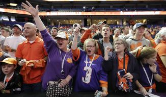 Clemson fans cheer during media day for the NCAA college football playoff championship game against Alabama Saturday, Jan. 7, 2017, in Tampa, Fla. (AP Photo/David J. Phillip)