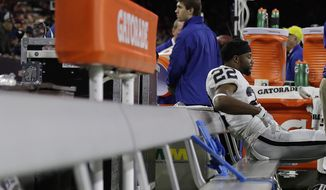 Oakland Raiders running back Taiwan Jones (22) sits on the bench after an AFC Wild Card NFL football game between the Houston Texans and the Oakland Raiders, Saturday, Jan. 7, 2017, in Houston. The Houston Texans won 27-14. (AP Photo/Eric Gay)