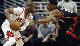 Chicago Bulls guard Dwyane Wade, left, drives against Toronto Raptors guard DeMar DeRozan during the first half of an NBA basketball game Saturday, Jan. 7, 2017, in Chicago. (AP Photo/Nam Y. Huh)