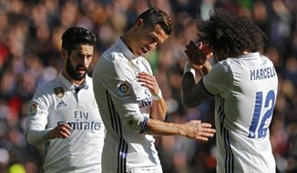 "Real Madrid's Cristiano Ronaldo, centre, celebrates with teammates Marcelo, right, and Francisco Roman ""Isco"" after scoring his team's third goal against Granada during the Spanish La Liga soccer match between Real Madrid and Granada at the Santiago Bernabeu stadium in Madrid, Saturday, Jan. 7, 2017. (AP Photo/Francisco Seco)"