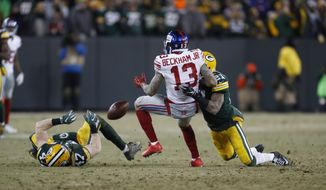 New York Giants' Odell Beckham (13) cannot make a catch during the second half of an NFC wild-card NFL football game against the Green Bay Packers, Sunday, Jan. 8, 2017, in Green Bay, Wis. (AP Photo/Matt Ludtke)