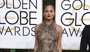 Chrissy Teigen arrives at the 74th annual Golden Globe Awards at the Beverly Hilton Hotel on Sunday, Jan. 8, 2017, in Beverly Hills, Calif. (Photo by Jordan Strauss/Invision/AP)