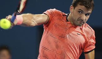 Grigor Dimitrov of Bulgaria plays a shot in his final match against Kei Nishikori of Japan at the Brisbane International tennis tournament in Brisbane, Australia, Sunday, Jan. 8, 2017. (AP Photo/Tertius Pickard)