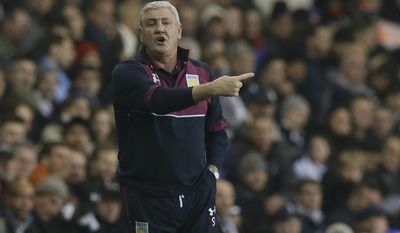 Aston Villa manager Steve Bruce looks across the pitch during the English FA Cup third round match between Tottenham Hotspur and Aston Villa at White Hart Lane in London, Sunday Jan. 8, 2017. (AP Photo/Tim Ireland)