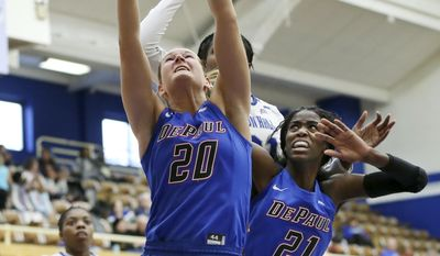 DePaul guard Kelly Campbell (20) grabs the ball in front of teammate Chantel Stonewall (21) during the first half of an NCAA college basketball game against Seton Hall, Sunday, Jan. 8, 2017, in South Orange, N.J. (AP Photo/Mel Evans)
