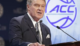 FILE - In a Oct. 28, 2015 file photo, Commissioner John Swofford speaks to the media during the Atlantic Coast Conference men's NCAA basketball media day in Charlotte, N.C. Swofford says the conference is likely to move its football championship game out of Charlotte, North Carolina, again if a state law that limits anti-discrimination protections for LGBT people is not repealed or adjusted. Swofford gave no timetable Sunday, Jan. 8, 2017,  for a decision on whether to relocate the 2017 game but he did say the conference will not wait as long as it did last year. (AP Photo/Chuck Burton, File)
