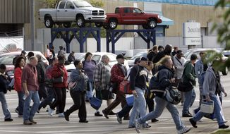 FILE - In an Oct. 24, 2007 file photo, workers leave the Warren Truck Assembly, a Chrysler automobile factory, during a shift change in Warren, Mich. Fiat Chrysler said Sunday, Jan. 8. 2017, it will add three new Jeeps to its lineup including a pickup truck as it invests $1 billion in two U.S. factories and creates 2,000 new jobs. (AP Photo/Carlos Osorio, File)