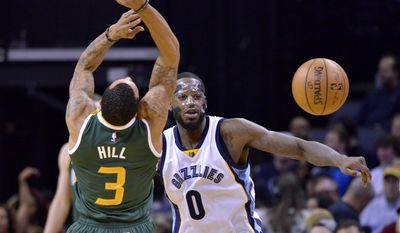 Memphis Grizzlies forward JaMychal Green (0) knocks the ball away from Utah Jazz guard George Hill (3) in the first half of an NBA basketball game Sunday, Jan. 8, 2017, in Memphis, Tenn. (AP Photo/Brandon Dill)