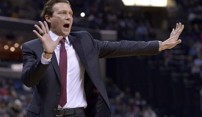 Utah Jazz head coach Quin Snyder calls to a referee in the first half of an NBA basketball game against the Memphis Grizzlies, Sunday, Jan. 8, 2017, in Memphis, Tenn. (AP Photo/Brandon Dill)