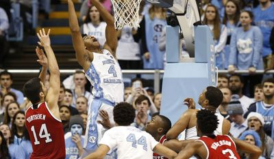 North Carolina forward Isaiah Hicks (4) goes to the basket against North Carolina State center Omer Yurtseven (14), guard Torin Dorn, center, and guard Terry Henderson (3) as North Carolina forwards Justin Jackson (44) and Kennedy Meeks, right rear, look on during the second half of an NCAA college basketball game Sunday, Jan. 8, 2017, in Chapel Hill, N.C. (AP Photo/Ellen Ozier)
