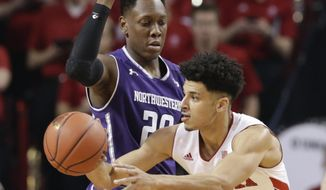 Nebraska's Tai Webster (0) passes the ball around Northwestern's Scottie Lindsey (20) during the first half of an NCAA college basketball game in Lincoln, Neb., Sunday, Jan. 8, 2017. (AP Photo/Nati Harnik)