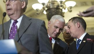 Vice President-elect Mike Pence speaks with Reince Priebus, chief of staff for President-elect Donald Trump, right, as Senate Majority Leader Mitch McConnell of Ky., left, speaks at a news conference on Capitol Hill in Washington, Wednesday, Jan. 4, 2017, following a Senate Republican Luncheon. (AP Photo/Cliff Owen)