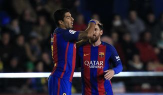 FC Barcelona's Lionel Messi, right, celebrates after scoring with his teammate Luis Suarez during the Spanish La Liga soccer match between Villarreal and Barcelona at the Ceramica stadium in Villarreal, Spain, Sunday, Jan. 8, 2017. (AP Photo/Alberto Saiz)