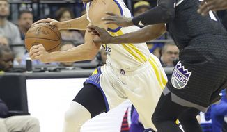 Golden State Warriors guard Stephen Curry, left, drives against Sacramento Kings guard Darren Collison during the first half of an NBA basketball game Sunday, Jan. 8, 2017, in Sacramento, Calif. (AP Photo/Rich Pedroncelli)