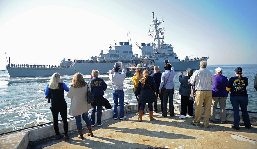 Families watch from a pier as the USS Mahan departs Naval Station Norfolk for a scheduled deployment on Nov. 19, 2016. (U.S. Navy)