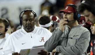 Alabama offensive coordinator Steve Sarkisian watches from the sidelines during the second half of the NCAA college football playoff championship game against Clemson Monday, Jan. 9, 2017, in Tampa, Fla. (AP Photo/David J. Phillip)