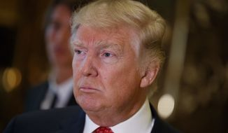 President-elect Donald Trump listens to a reporters question at Trump Tower in New York, Monday, Jan. 9, 2017. (AP Photo/Evan Vucci)