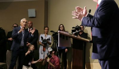 FILE - In this Aug. 25, 2015, file photo, Miami-based Univision anchor Jorge Ramos, left, asks Republican presidential candidate Donald Trump a question about his immigration proposal during a news conference in Dubuque, Iowa. Ramos was later removed from the room. Trump spokesman Sean Spicer said on Monday, Jan. 9, 2017, that the President-elect would meet with Univision President and CEO Randy Falco and the company's chief news and digital officer, Isaac Lee. The meeting happens after Trump and the Spanish-language broadcaster clashed repeatedly during the presidential campaign. (AP Photo/Charlie Neibergall, File)