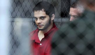 Esteban Santiago is taken from the Broward County main jail as he is transported to the federal courthouse in Fort Lauderdale, Fla., on Monday, Jan. 9, 2017. Santiago is accused of fatally shooting several people at a crowded Florida airport baggage claim and faces airport violence and firearms charges that could mean the death penalty if he's convicted. (Amy Beth Bennett/South Florida Sun-Sentinel via AP)