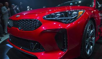 Kia Motors America unveils the 2018 Kia Stinger during the North American International Auto Show in Detroit, Sunday, Jan. 8, 2017. (Matt Weigand/The Ann Arbor News via AP)