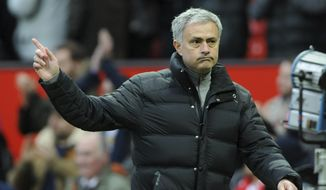 Manchester United's manager Jose Mourinho acknowledges the crowd as he walks from the pitch after the end of the English FA Cup Third Round match between Manchester United and Reading at Old Trafford in Manchester, England, Saturday, Jan. 7, 2017. United won the match 4-0. (AP Photo/Rui Vieira)
