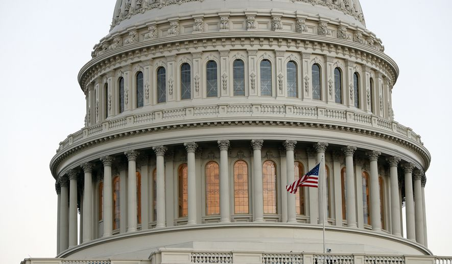 The American flag flies in front of the U.S. Capitol dome at sunset on Capitol Hill in Washington in this Nov. 18, 2016, file photo. The end of the 2016 presidential election is at hand. (AP Photo/Alex Brandon, file)