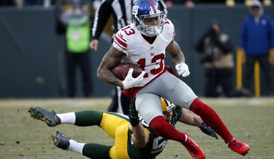 New York Giants wide receiver Odell Beckham (13) runs away from, Green Bay Packers inside linebacker Blake Martinez (50) after receiving a pass during the first half of an NFC wild-card NFL football game, Sunday, Jan. 8, 2017, in Green Bay, Wis. (AP Photo/Mike Roemer)