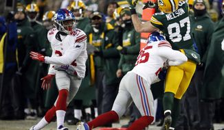 New York Giants defensive back Leon Hall (25) breaks up a pass intended for Green Bay Packers wide receiver Jordy Nelson (87) during the first half of an NFC wild-card NFL football game, Sunday, Jan. 8, 2017, in Green Bay, Wis. Nelson was injured and left the game after this play. (AP Photo/Mike Roemer)