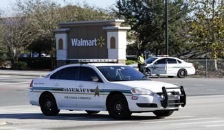 Orange County Sheriff's officers block the entrance to a Walmart near the scene where a police officer was shot, Monday, Jan. 9, 2017, in Orlando, Fla. Orlando police say the officer who was shot while on duty has died; a manhunt is underway for the suspect.(AP Photo/John Raoux)