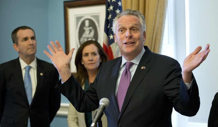 Virginia Gov. Terry McAuliffe, right, gestures during a news conference as his wife, Dorothy and Lt. Gov. Ralph Northam, left, listen at the Capitol in Richmond, Va., Tuesday, Jan. 10, 2017. McAuliffe detailed his ethics reform legislative package. (AP Photo/Steve Helber)