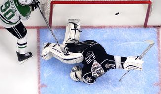 Los Angeles Kings goalie Peter Budaj, of Slovakia, is scored on by Dallas Stars center Tyler Seguin as center Jason Spezza, left, stands by during the first period of an NHL hockey game, Monday, Jan. 9, 2017, in Los Angeles. (AP Photo/Mark J. Terrill)