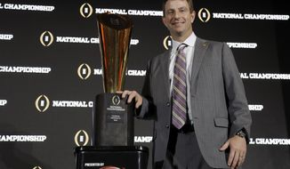 Clemson head coach Dabo Swinney poses with the championship trophy after an NCAA college football news conference Tuesday, Jan. 10, 2017, in Tampa, Fla. Clemson defeated Alabama 35-31 in the College Football Playoff National Championship Game. (AP Photo/Chris O'Meara)