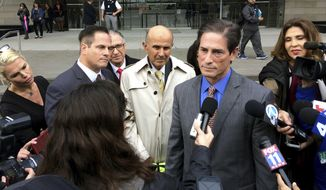 Former Los Angeles Sheriff Lee Baca, center, listens as his lawyer, Nathan Hochman, second from right, addresses the media in Los Angeles on Tuesday, Jan. 10, 2017. U.S. prosecutors will retry Baca on obstruction-of-justice and other charges stemming from a federal investigation of jail abuses. (AP Photo/Brian Melley)