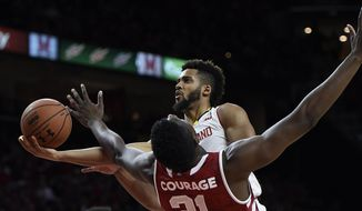 Maryland's Melo Trimble drives to the basket as Indiana's Thomas Bryant defends during the second half of an NCAA college basketball game, Tuesday, Jan. 10, 2017, in College Park, Md.Maryland won 75-72. (AP Photo/Gail Burton)