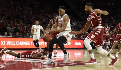 Maryland's Justin Jackson drives to the basket as Indiana's James Blackmon Jr., right, pursues during the first half of an NCAA college basketball game, Tuesday, Jan. 10, 2017, in College Park, Md. (AP Photo/Gail Burton)