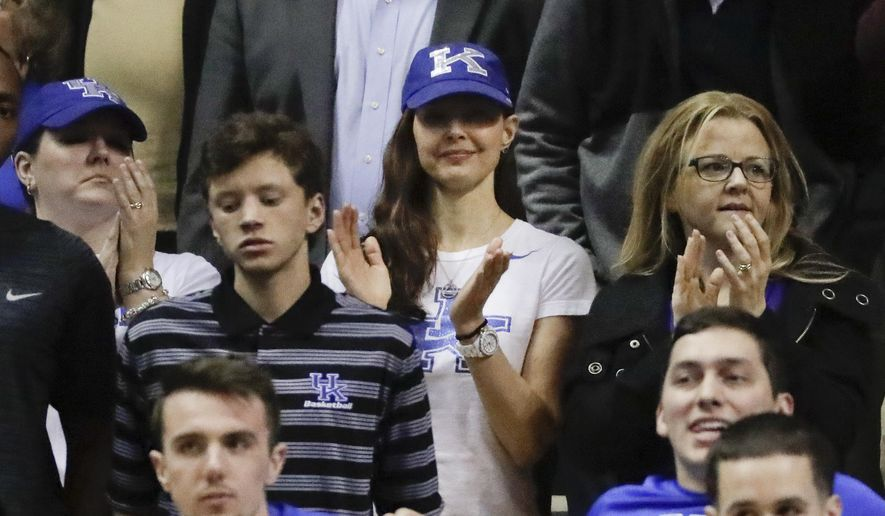 Actress and Kentucky fan Ashley Judd, center, cheers from behind the team bench during the second half of Kentucky's NCAA college basketball game against Vanderbilt on Tuesday, Jan. 10, 2017, in Nashville, Tenn. Kentucky won 87-81. (AP Photo/Mark Humphrey)