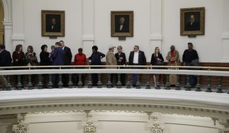 Guests line up in the rotunda of the Texas State Capitol as they wait to enter the House Chambers for the 85th Texas Legislative session to begin, Tuesday, Jan. 10, 2017, in Austin, Texas. (AP Photo/Eric Gay)