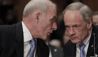 Homeland Security Secretary-designate John Kelly, left, confers with Sen. Tom Carper, D-Del., as he appears on Capitol Hill in Washington, Tuesday, Jan. 10, 2017, to testify at his confirmation hearing before the Senate Homeland Security and Governmental Affairs Committee.  (AP Photo/J. Scott Applewhite)