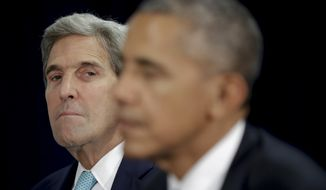 Secretary of State John Kerry looks toward President Barack Obama during a bilateral meeting with Nigerian President Muhammadu Buhari on the margins of 71st session of the United Nations General Assembly, Tuesday, Sept. 20, 2016. (AP Photo/Carolyn Kaster)