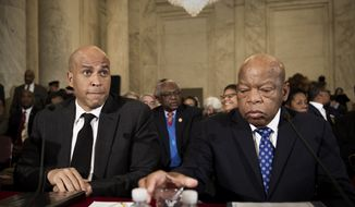 Sen. Cory Booker, D-N.J., left, and Rep. John Lewis, D-Ga., testify on Capitol Hill in Washington, Wednesday, Jan. 11, 2017, at the second day of a confirmation hearing for Attorney General-designate, Sen. Jeff Sessions, R-Ala., before the Senate Judiciary Committee. (AP Photo/Cliff Owen)