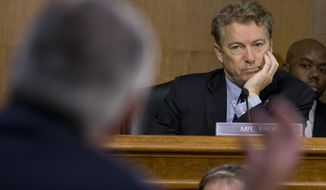 Senate Foreign Relations Committee member Sen. Rand Paul, R-Ky. listens at right as Secretary of State-designate Rex Tillerson testifies on Capitol Hill in Washington, Wednesday, Jan. 11, 2017, during his confirmation hearing before the committee. (Associated Press) **FILE**