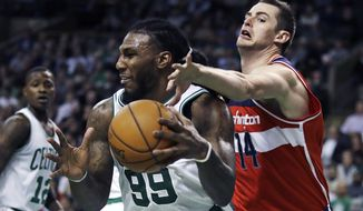 Washington Wizards forward Jason Smith (14) tries to knock the ball away from Boston Celtics forward Jae Crowder (99) during the second half of an NBA basketball game in Boston, Wednesday, Jan. 11, 2017. The Celtics defeated the Wizards 117-108. (AP Photo/Charles Krupa)