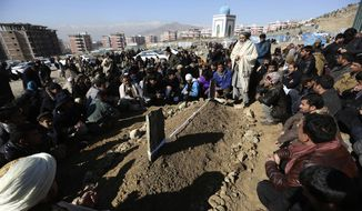 Villagers pray in front of the grave of a victim of Tuesday's two bombings in Kabul, Afghanistan, Wednesday, Jan. 11, 2017. The Taliban claimed attacks earlier on Tuesday in Kabul that killed at least 38 people and wounded dozens. (AP Photo/Rahmat Gul) ** FILE **