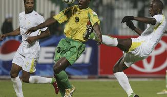 FILE - In this Monday Jan. 23, 2006 file photo, Zimbabwe's Mwariwari Benjani, center, controls the ball past Senegal's Diawara Souleymane and Beye Amdy, left, during the African Nations Cup Group D soccer match between Senegal and Zimbabwe in Port Said Stadium, Egypt. The African Cup of Nations returns to Gabon for the second time in five years with the kickoff on Saturday Jan. 14, 2017 and the final on Feb. 5. (AP Photo/Ariel Schalit, File)