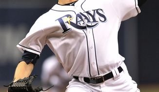 FILE - In this Tuesday, Sept. 20, 2016 file photo, Tampa Bay Rays starter Drew Smyly pitches against the New York Yankees during the first inning of a baseball game in St. Petersburg, Fla. The Mariners have made a pair of trades, landing left-handed starter Drew Smyly from the Tampa Bay Rays and right-hander reliever Shae Simmons from the Atlanta Braves, Wednesday, Jan. 11, 2017. (AP Photo/Steve Nesius, File)