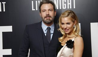 Actors Ben Affleck and Sienna Miller pose for photographers upon arrival at the premiere of the film 'Live By Night' in London, Wednesday, Jan. 11, 2016. (Photo by Joel Ryan/Invision/AP)