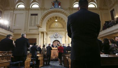 Members of the New Jersey legislature stand and applaud as New Jersey Gov. Chris Christie, center, stands in the Assembly chamber of the Statehouse as he delivers his State Of The State address Tuesday, Jan. 10, 2017, in Trenton, N.J. (AP Photo/Mel Evans)