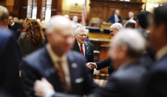 "Georgia Gov. Nathan Deal shakes hands as he leaves the House floor after delivering the State of the State address in Atlanta, Wednesday, Jan. 11, 2017. Deal is asking Georgia lawmakers to support a new plan for fixing low-performing schools after voters last fall rejected a proposal for state takeovers of schools that consistently struggle. The Republican governor said in his State of the State speech Wednesday that nearly 89,000 students were stuck in failing schools last year and their number ""will grow with each passing school year"" if nothing is done. (AP Photo/David Goldman)"