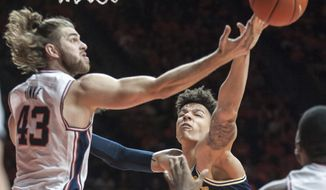 Illinois forward Michael Finke (43) and Michigan forward D.J. Wilson (5) battle for a rebound during the first half of an NCAA college basketball game in Champaign, Ill., Wednesday, Jan. 11, 2017. (AP Photo/Rick Danzl)