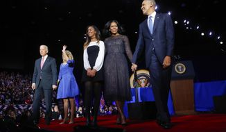 President Barack Obama walks on stage with first lady Michelle Obama, daughter Malia, Vice President Joe Biden and his wife Jill Biden after his farewell address at McCormick Place in Chicago, Tuesday, Jan. 10, 2017. (AP Photo/Pablo Martinez Monsivais)